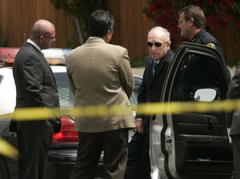 San Diego Police Chief William Landsdowne (second from right) talks with officers outside the North Park home where Bradford Sarten was shot in a confrontation with police.