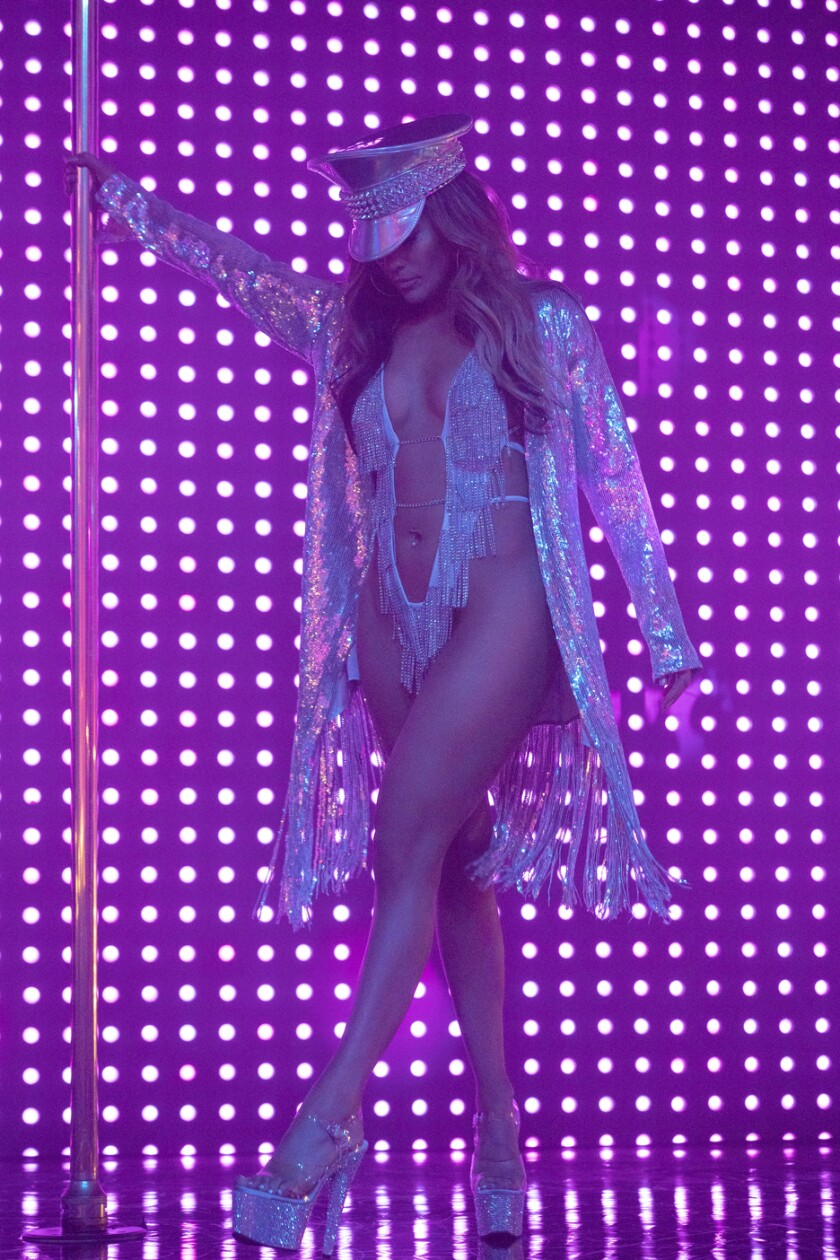 """This image released by STXfilms shows Jennifer Lopez, in a scene from """"Hustlers."""" Though Lopez was nominated for a Golden Globe and other awards this year, and had received the best reviews of her career for her role as a New York stripper, she missed out on an Oscar nomination on Monday. (Barbara Nitke/STXfilms via AP)"""