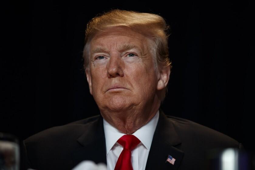 President Donald Trump listens during the National Prayer Breakfast, Thursday, Feb. 7, 2019, in Washington.