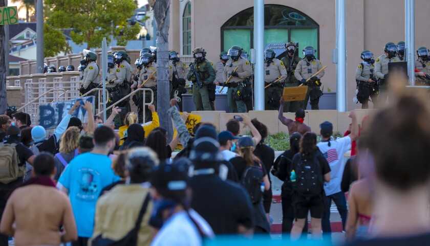 Sheriff deputies position themselves in front of the La Mesa police station during a protest on May 30.