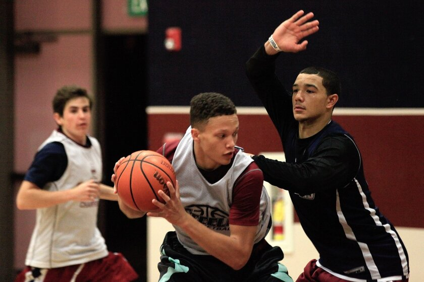 Steele Canyon power forwards senior Dylan Hamlett (left) and junior Dominick Wood-Anderson square off at practice.