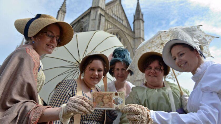 Fans in Regency-era dress with the new Jane Austen bank note.