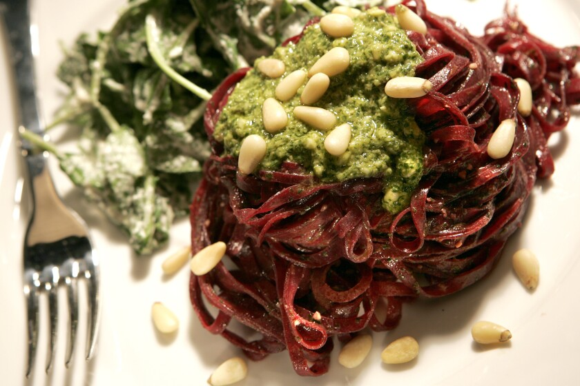 Looking for a spiralizer recipe? Try this vegan beet pasta with cilantro pesto