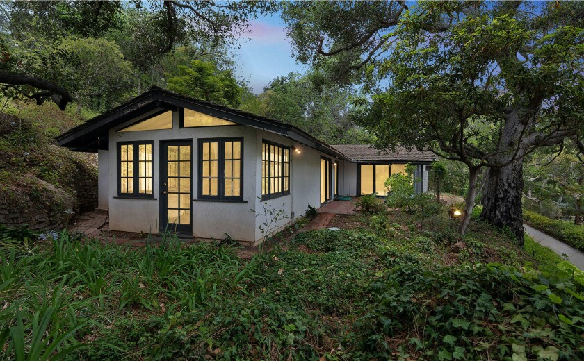 The single-story home is tucked into a leafy lot near Sullivan Canyon Park.