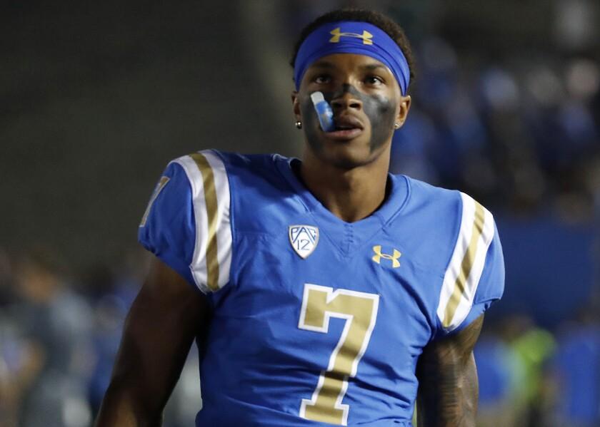 UCLA quarterback Dorian Thompson-Robinson looks on during a game.
