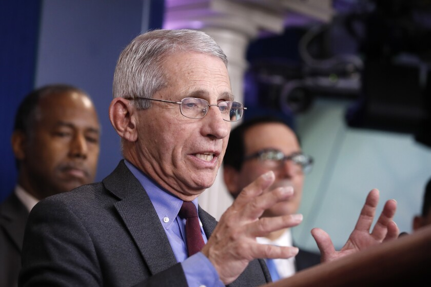 Dr. Anthony Fauci, director of the National Institute of Allergy and Infectious Diseases, speaks during a briefing on coronavirus on Saturday at the White House in Washington.