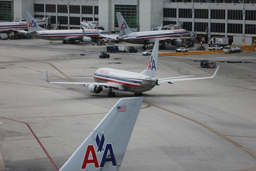 American Airlines and US Airways are pushing for an earlier trial date, in November, in their fight with the Justice Department.