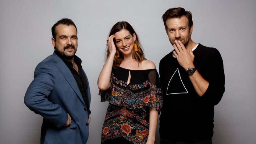 "Writer-director Nacho Vigalondo, left, with actors Anne Hathaway and Jason Sudeikis of ""Colossal."" T"