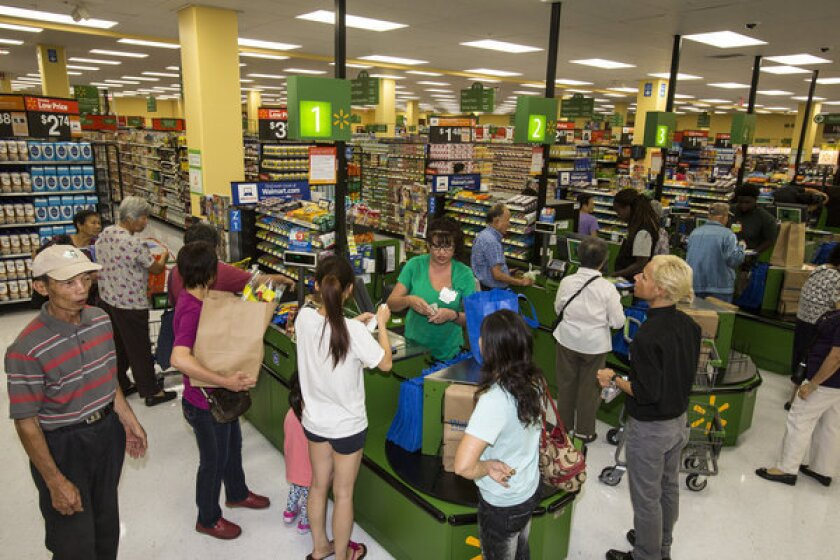 Wal-Mart soft-opened a Neighborhood Market in Chinatown on Friday.