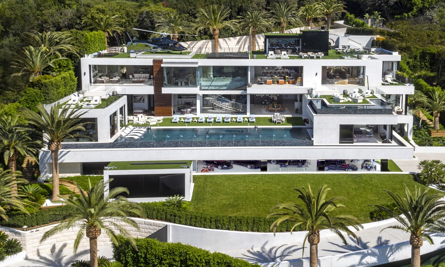 Handbag mogul turned speculative developer Bruce Makowsky sold his latest creation in Bel-Air for $94 million, down considerably from the original asking price of $250 million. The 38,000-square-foot house sits on more than an acre and features three kitchens, a 40-seat movie theater and a bowling alley. A decommissioned helicopter serves as decoration on the rooftop deck.