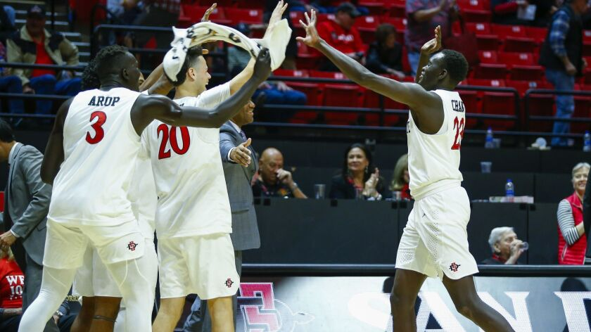 SDSU freshman Ed Chang (right) celebrates with teammates after making a 3-pointer later in a 103-64 win against Texas Southern.