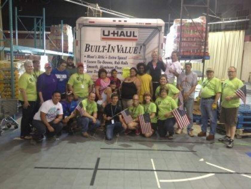 Gordon and Maureen Dunfee and the Murphy Canyon Mamas pose in front of the truck the couple drove more than 1,300 miles to Oklahoma. It contained supplies to assist those recovering from a deadly tornado that struck Moore, Okla. on May 20. Courtesy