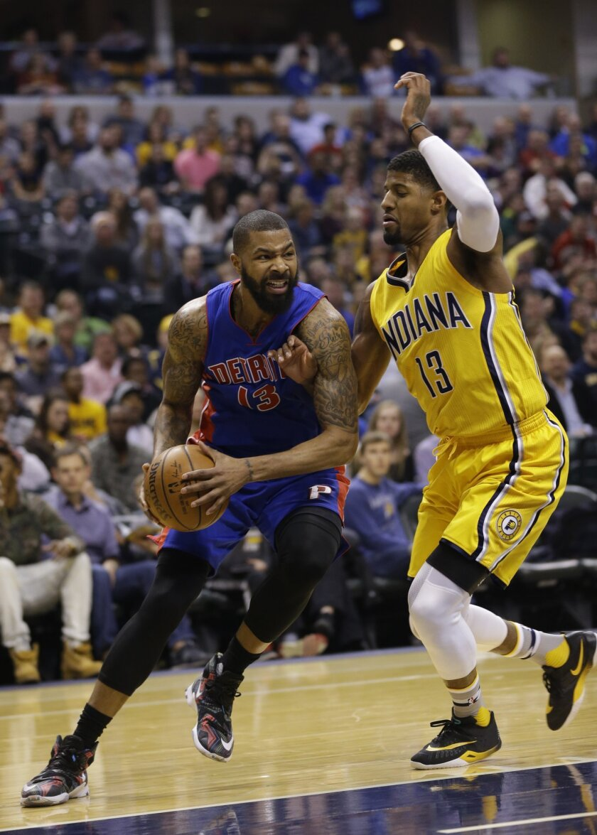 Detroit Pistons forward Marcus Morris, left, drives on Indiana Pacers forward Paul George during the first half of an NBA basketball game in Indianapolis, Saturday, Feb. 6, 2016. (AP Photo/Michael Conroy)