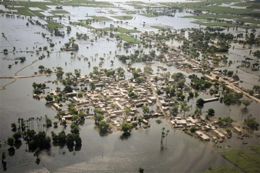 Houses are half submerged in floodwater in Mithan Kot, in central Pakistan, Monday, Aug. 9, 2010. The government has struggled to cope with the scale of the disaster, which has killed at least 1,500 people, prompting the international community to help by donating tens of millions of dollars and pr