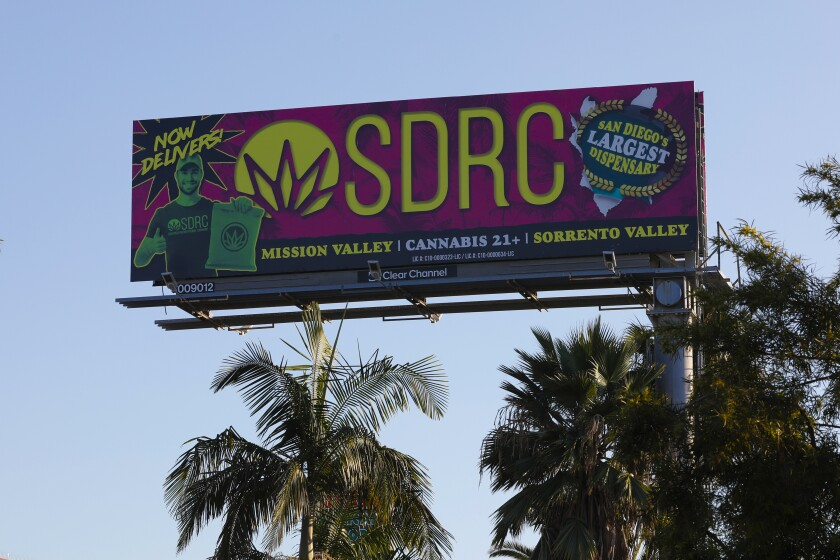 A billboard located on Rosecrans and Hancock Street advertises locations of cannabis dispensary in San Diego. The San Diego City Council has banned marijuana billboard ads within 1,000 feet of schools, playgrounds, day care centers, youth centers and public parks with playgrounds.