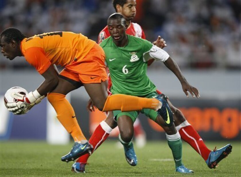Zambia's goalkeeper Kennedy Mweene, makes a save as teammate Emmanuel Mbola blocks out a Tunisian player in their African Cup of Nations Group D soccer match at Tundavala Stadium in Lubango, Angola Wednesday, Jan. 13, 2010. (AP Photo/Rebecca Blackwell)
