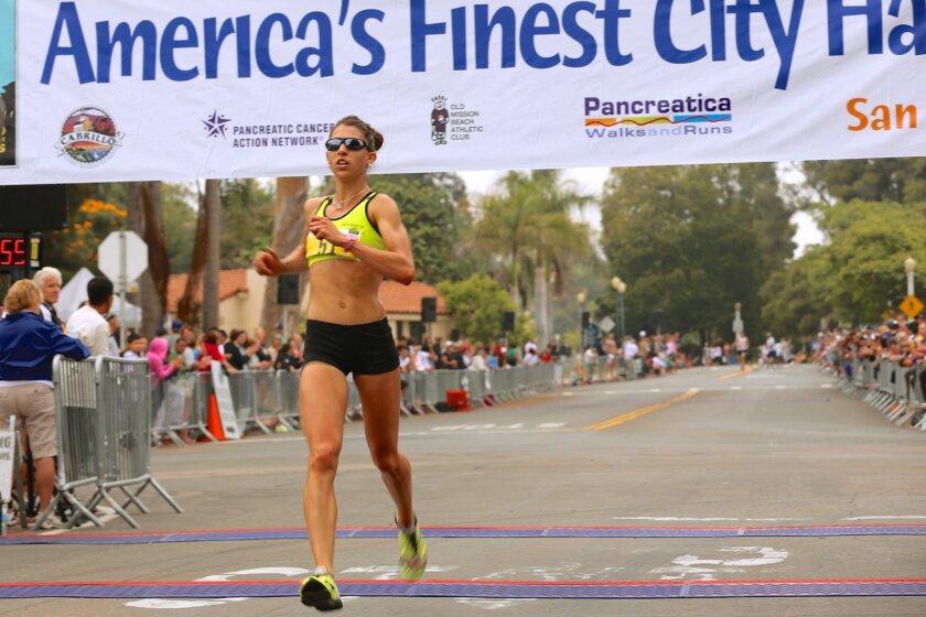Natasha LaBeaud Anzures' half marathon best is 1:14:54.