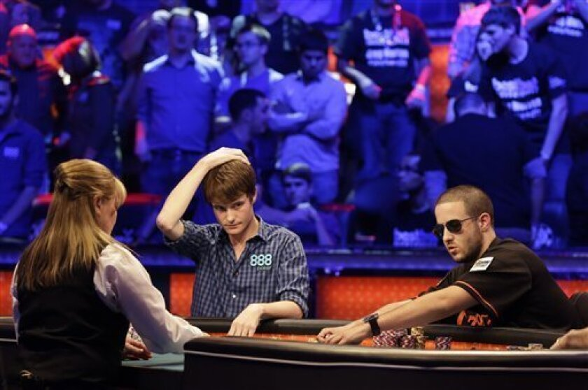 Jake Balsiger, left, reacts as Greg Merson pulls in the pot after snap folding on an all in bet by Merson during the World Series of Poker Final Table event, Tuesday, Oct. 30, 2012, in Las Vegas. (AP Photo/Julie Jacobson)