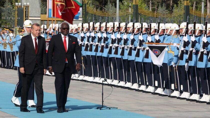 Turkish President Recep Tayyip Erdogan, left, welcomes Sierra Leone President Ernest Bai Koroma to t