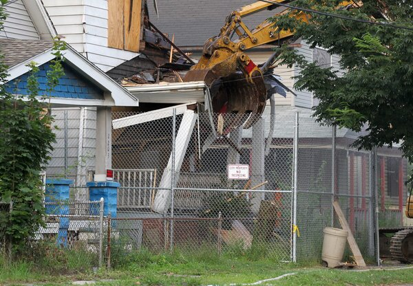 The home where Ariel Castro held three women captive is torn down Wednesday as part of a deal that spared Castro a possible death sentence. After pleading guilty he was sentenced last week to life in prison plus 1,000 years.