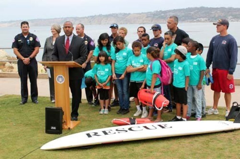 Council President Tony Young talks about the 'Fill the Fin' Campaign at La Jolla Cove. Photo: Dave Schwab