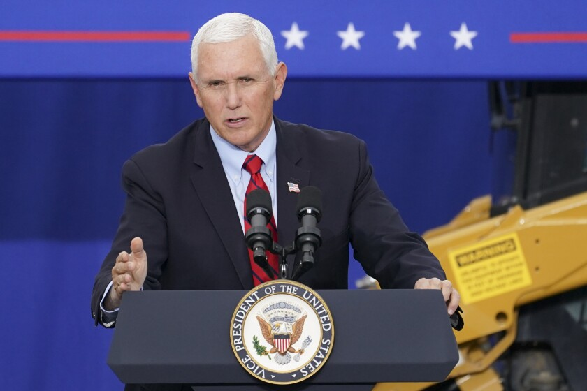 FILE - In this Tuesday, Sept. 1, 2020, file photo, Vice President Mike Pence speaks at a campaign event on the grounds of Kuharchik Construction, Inc., in Exeter, Pa. Labor Day kicks off the unofficial start to fall election campaign. (AP Photo/John Minchillo, File)
