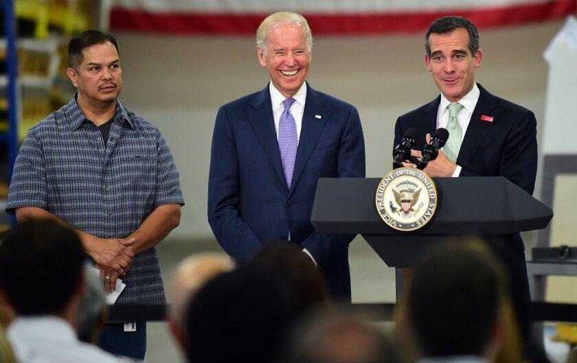 Joe Biden, center, and Eric Garcetti, right
