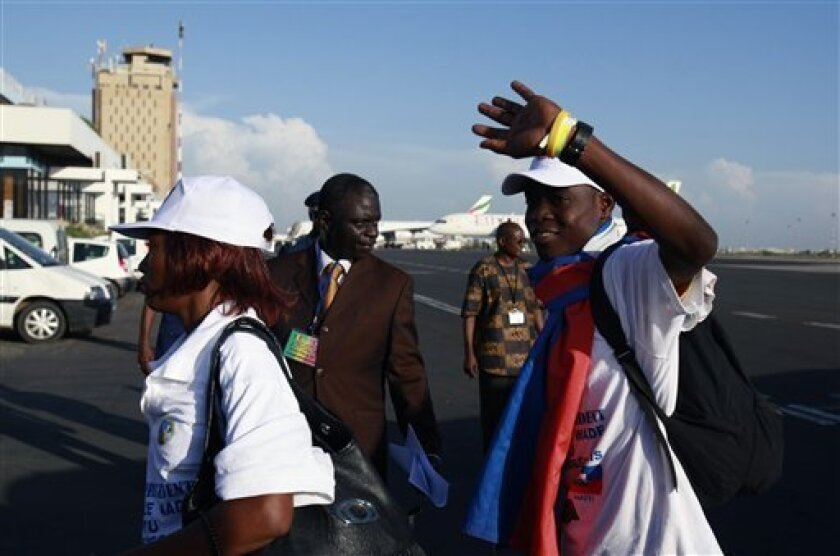 A Haitian student gestures as he arrives at the airport in Dakar, Senegal Wednesday, Oct. 13, 2010. Senegal is one of the poorest countries in the world and its GDP is only marginally higher than Haiti's, but that didn't stop the government from going ahead with a plan to offer a new home to 163 victims of Haiti's devastating quake who arrived on a chartered jet Wednesday.(AP Photo/Rebecca Blackwell)