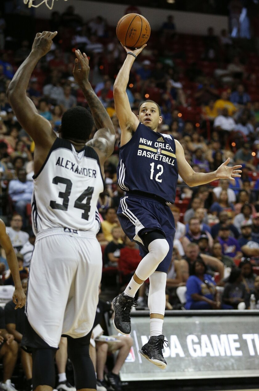 New Orleans Pelicans' Seth Curry shoots over Brooklyn Nets' Cliff Alexander during the second half of an NBA summer league basketball game, Monday, July 13, 2015, in Las Vegas. (AP Photo/John Locher)