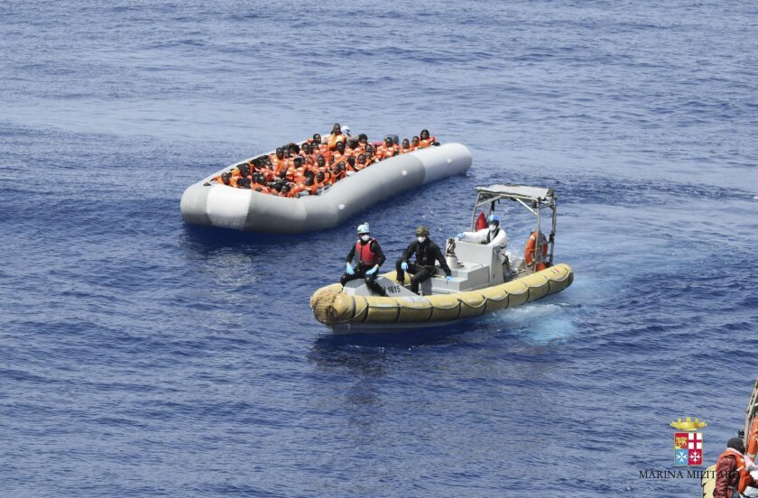 This undated image made available Monday, May 30, 2016 by the Italian Navy Marina Militare shows migrants being rescued at sea. Survivor accounts have pushed to more than 700 the number of migrants feared dead in Mediterranean Sea shipwrecks over three days in the past week, even as rescue ships sa