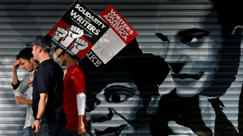 Skalij, Wally –– – Protestors walk down down Hollywood Blvd. during a march Tuesday in support of th