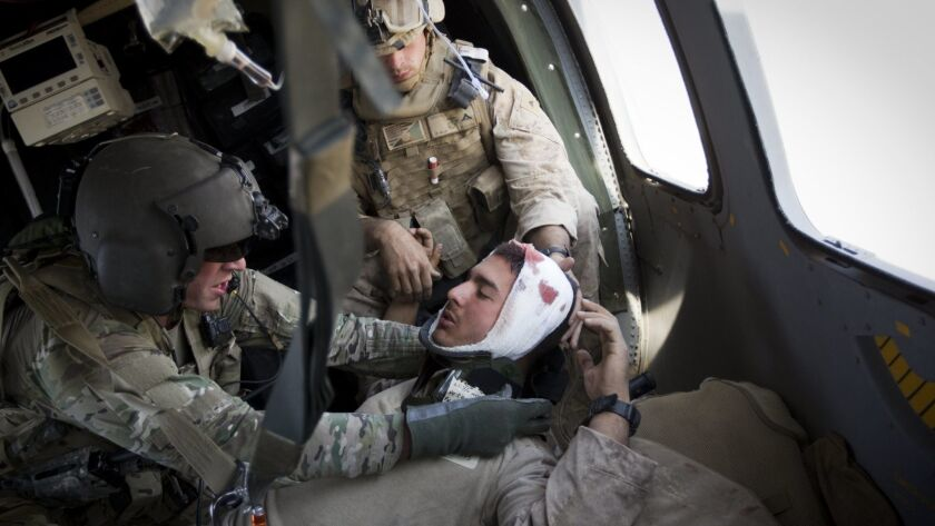 A wounded Marine who suffered a concussion is evacuated from Afghanistan's Helmand province in 2011. A new study of veterans found that traumatic brain injuries, even mild ones, were associated with an increased risk of dementia.