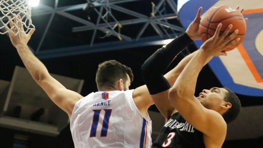 SDSU's Trey Kell (3) shoots past Boise State's Zach Haney in their game last year in Boise, a 78-66 Broncos victory.