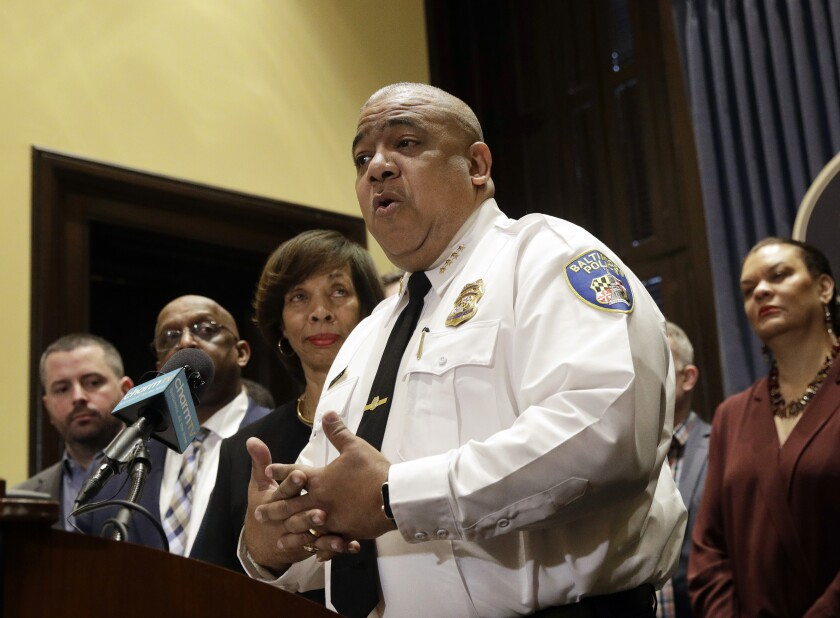 In this Feb. 11, 2019, photo, Michael Harrison, center, acting commissioner of the Baltimore Police Department, speaks at an introductory news conference in Baltimore. Authorities say 12 people have been shot, five of them fatally, in eight separate weekend shootings in Baltimore. (AP Photo/Patrick Semansky)
