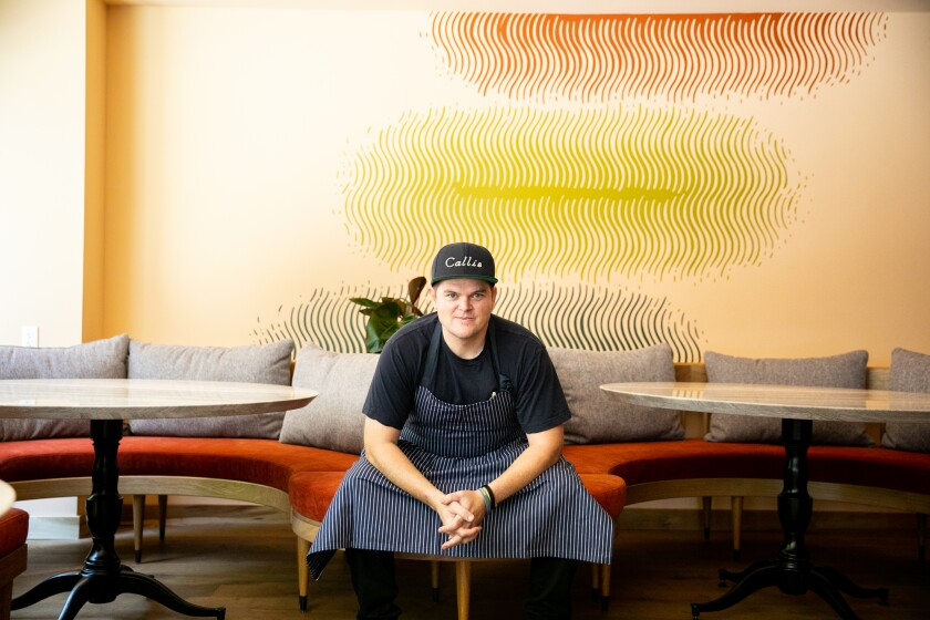Chef Travis Swikard poses for a portrait at his highly anticipated East Village restaurant Callie
