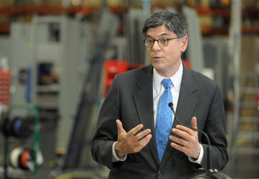 Treasury Secretary Jacob Lew speaks after touring the Siemens manufacturing plant where electrical drive components for heavy machinery are assembled in Alpharetta, Ga., Thursday, March 14, 2013. Some of the company's large traction drive clients include AMTRAK, Caterpillar and the new Atlanta Stre