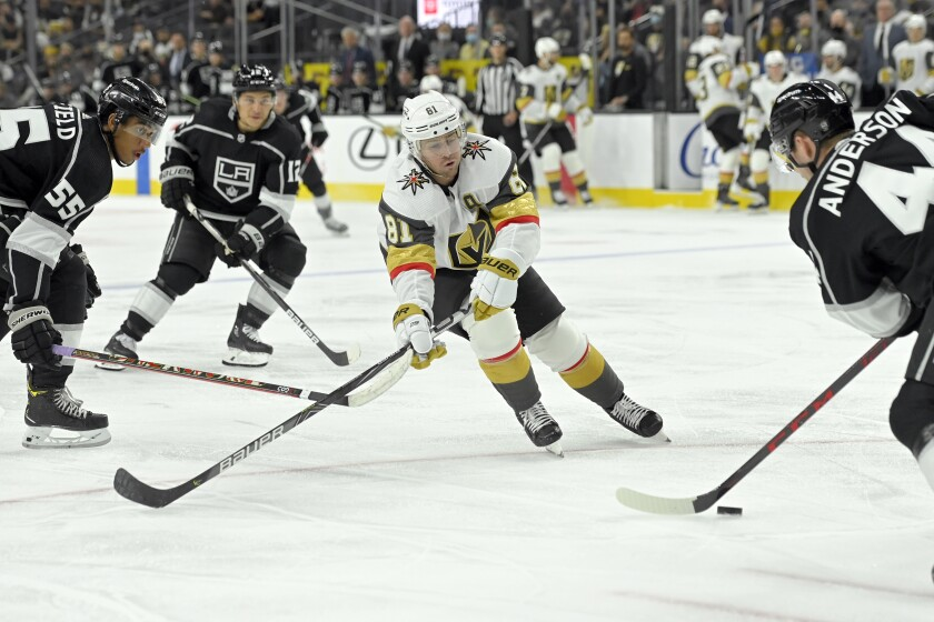 Vegas Golden Knights center Jonathan Marchessault (81) looks to block the puck against the Los Angeles Kings during the second period of an NHL preseason hockey game Friday, Oct. 1, 2021, in Las Vegas. (AP Photo/David Becker)