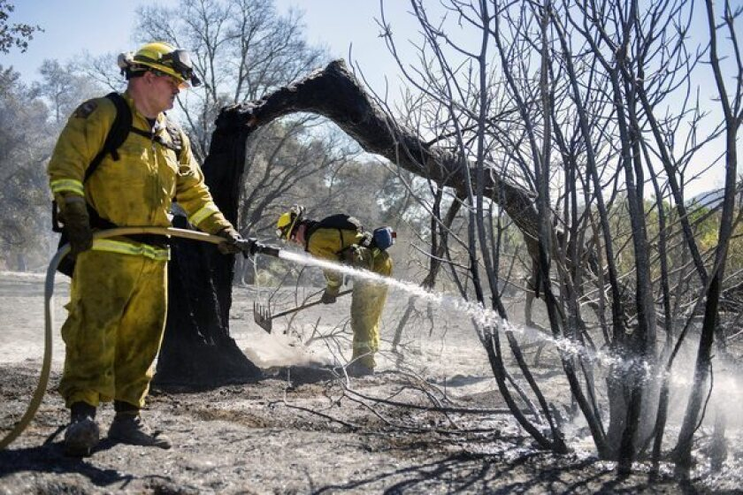 Firefighters complete containment on part of a fire in Twin Pines, Calif.