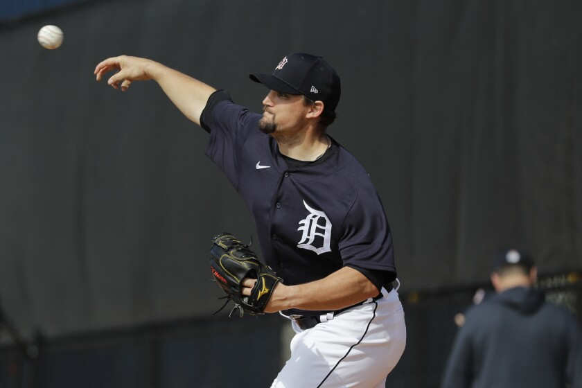 Detroit Tigers' Zack Godley throws during a spring training baseball workout Saturday, Feb. 15, 2020, in Lakeland, Fla. (AP Photo/Frank Franklin II)