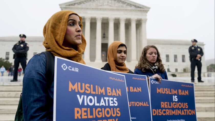 Members of the Council on American-Islamic Relations stand outside of the Supreme Court for an anti-Muslim ban rally on April 25.