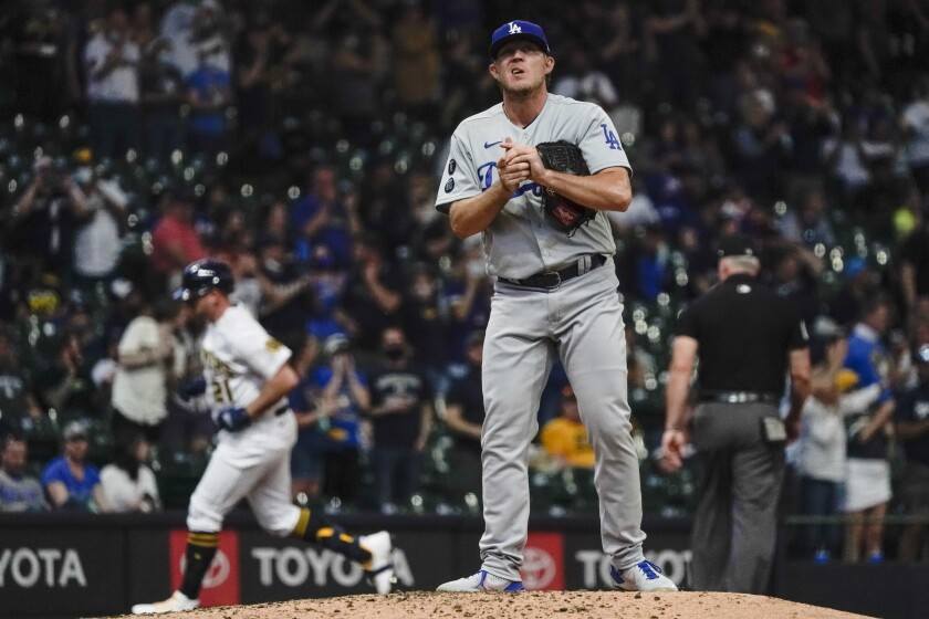 Dodgers reliever Garrett Cleavinger reacts after giving up a home run to Milwaukee's Travis Shaw.