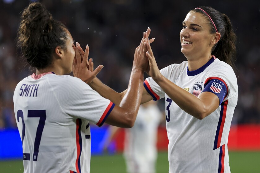 United States forward Alex Morgan, right, high-fives Sophia Smith after scoring a goal during the second half of an international friendly soccer match against Paraguay, Tuesday, Sept. 21, 2021, in Cincinnati. The United States won 8-0. (AP Photo/Aaron Doster)