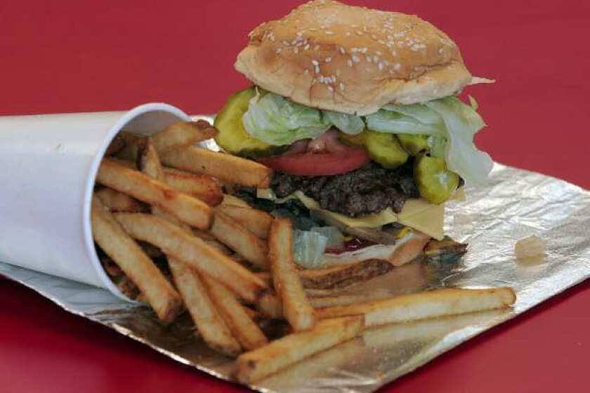 """A bacon cheeseburger """"all the way"""" is served at a Five Guys Burgers and Fries in Fremont, Calif."""