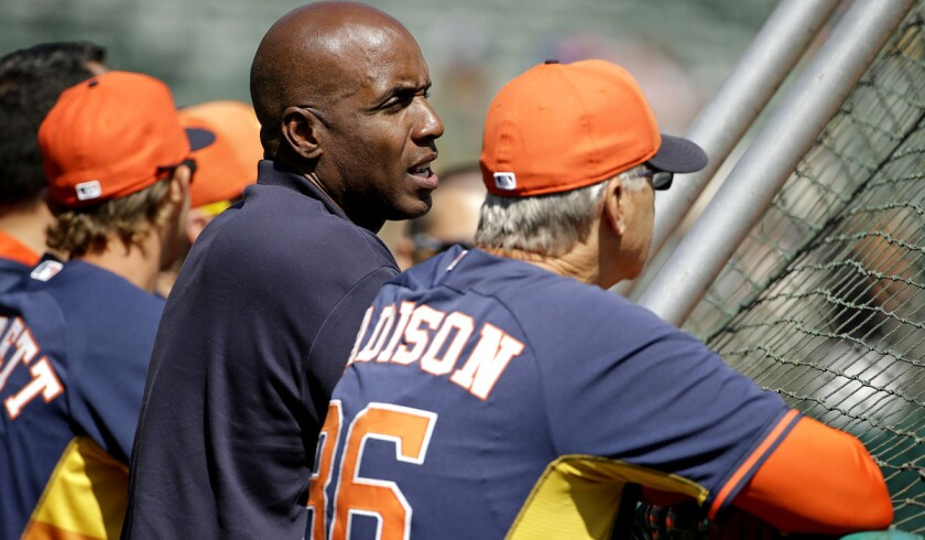 Former Giants slugger Barry Bonds, center, talks with Houston Astros special assignment coach Dan Radison during batting practice before a game against the Oakland A's this month.