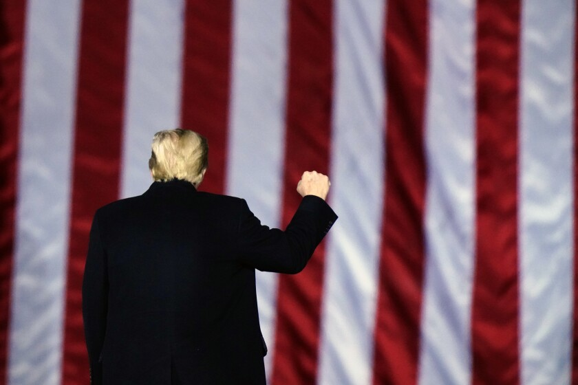President Trump pumps his fist at a campaign rally in support of GOP Senate candidates in Georgia on Jan. 4.