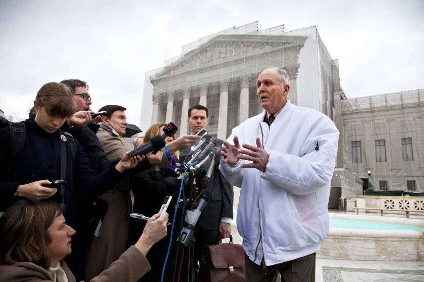 The Supreme Court unanimously found that farmer Vernon Hugh Bowman violated Monsanto's patent on herbicide-resistant soybean seeds. Above, Bowman speaks with reporters in February outside the Supreme Court in Washington.