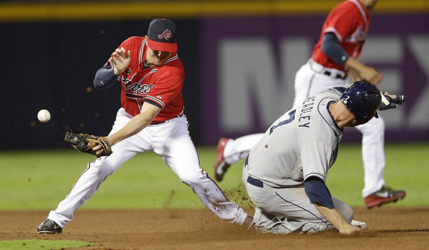 The Padres' Chase Headley steals second in the fourth inning as the ball gets away from the Braves' Elliot Johnson.