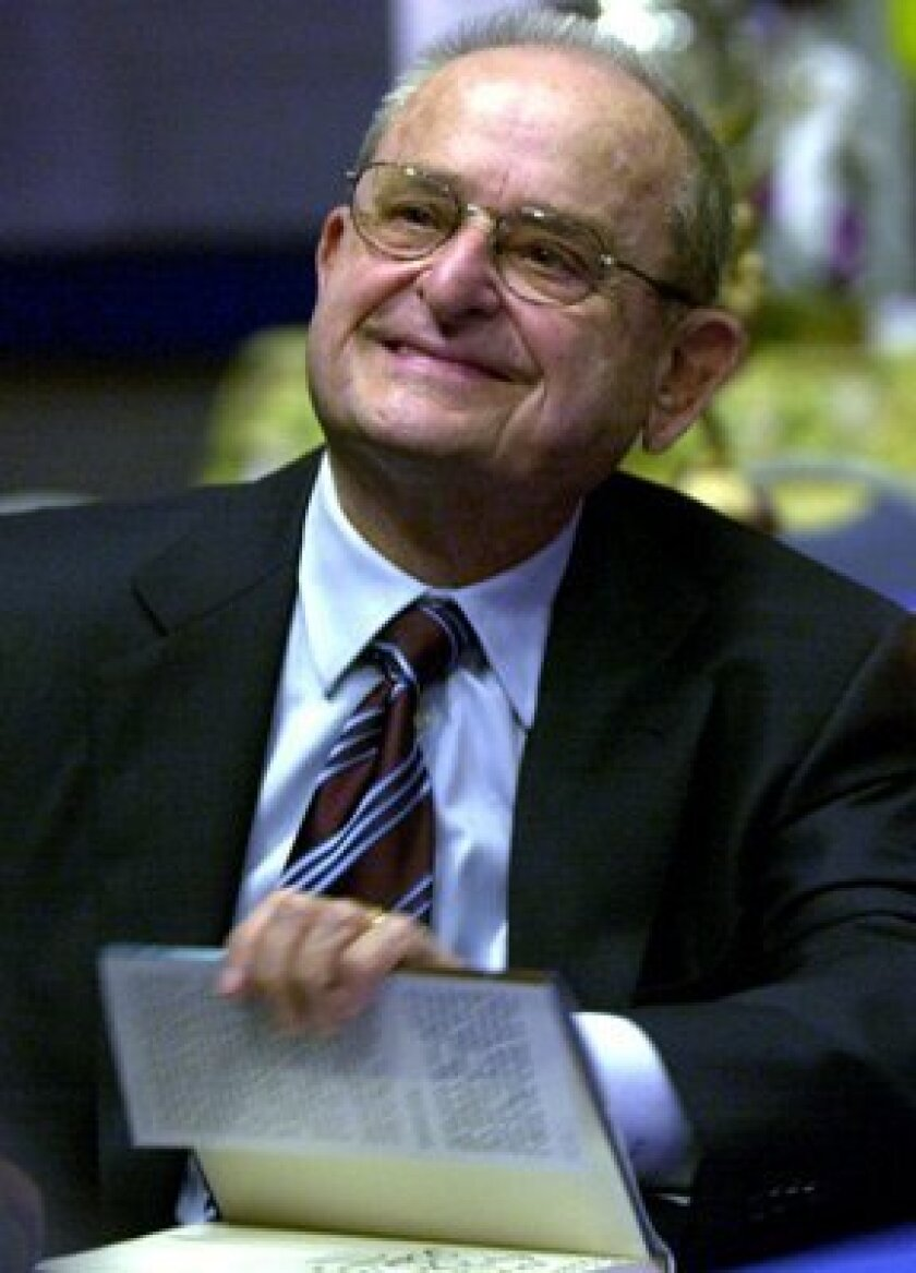 Alex Spanos signs his autobiography at the Hall of Champions Sports Museum in Balboa Park in 2002.
