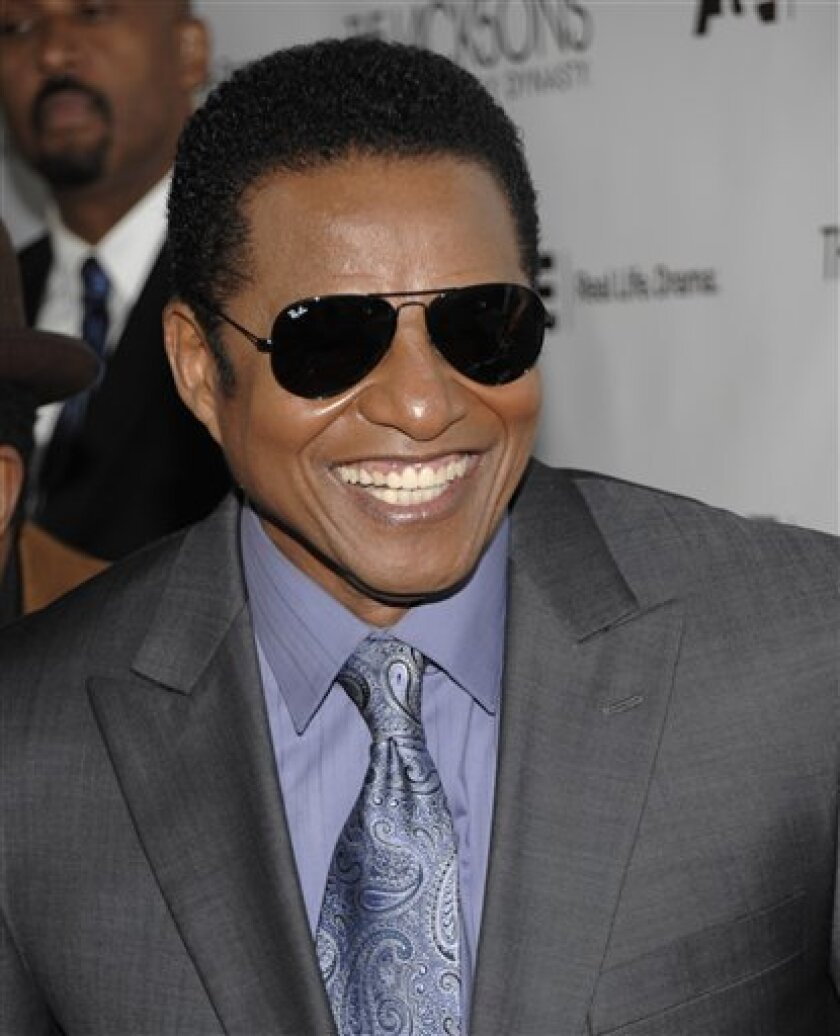 """Singer Jackie Jackson arrives at the launch party for """"The Jacksons: A Family Dynasty"""" reality show debuting on A&E Network on Wednesday, Dec. 9, 2009. (AP Photo/Dan Steinberg)"""