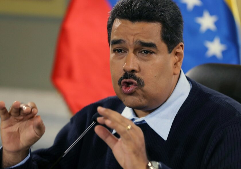 FILE - In this Aug. 24, 2015 file photo, Venezuela's President Nicolas Maduro gives a news conference at Miraflores presidential palace in Caracas, Venezuela. On Sunday, Oct. 18, 2015, Maduro called for prosecution of Lorenzo Mendoza, Venezuela's biggest businessman, president of the Empresas Polar